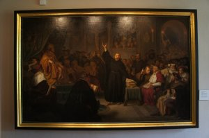 An artistic rendering of Luther defending his theology at the Diet of Worms.